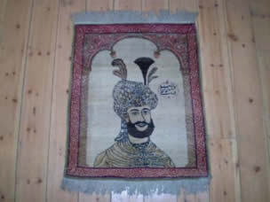 A pair of Kirman pictorial rugs depicting Tahmasp I, each 75 x 60cm